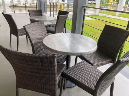 Tables and chairs in an empty atmosphere