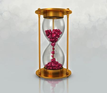 corazon rosa: la arena del reloj y el coraz�n de color rosa