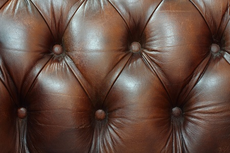 brown leather sofa: Classic brown leather texture.