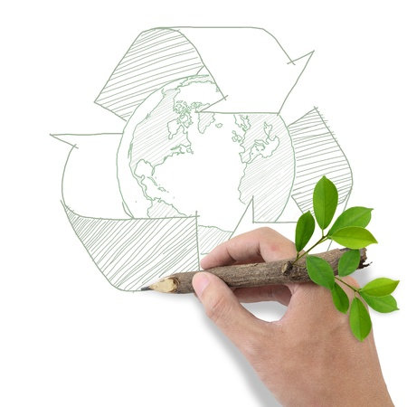 recyclable: Male hand drawing recycle and world symbol  Stock Photo