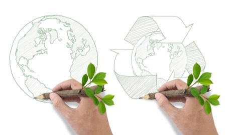 organic waste: Male hand drawing recycle and world symbol  Stock Photo