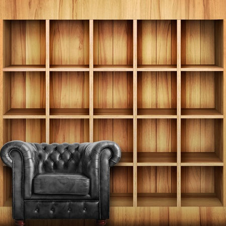 Classic black leather armchair with Wooden book Shelf background  photo