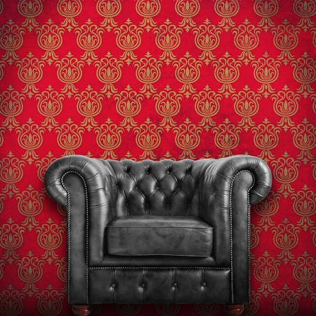 Classic black leather armchair with Red wallpaper background  photo
