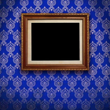 picture frame on wall: Gold frame with Blue wallpaper background  Stock Photo