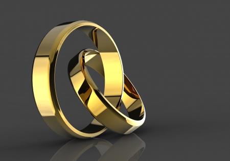 simbolo uomo donna: Closeup di fedi nuziali in oro su sfondo nero