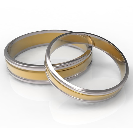 Closeup of Platinum and Gold wedding bands on white background Stock Photo - 13427780