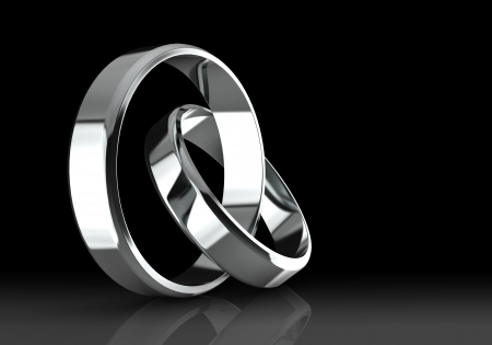 platinum wedding ring: Closeup of Platinum wedding bands on a black background