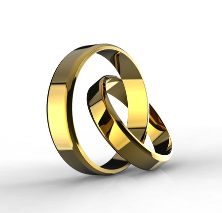 Closeup of Gold wedding bands on white background  photo
