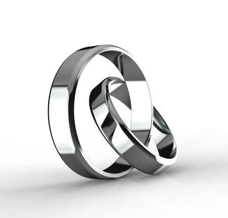 Closeup of Platinum wedding bands on white background  photo