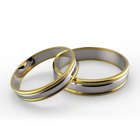 Closeup of Platinum and Gold wedding bands on white background  Stock Photo - 13427772