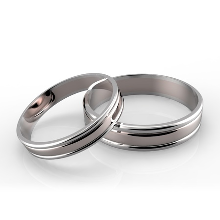 Closeup of Platinum wedding bands on white background  Stock Photo