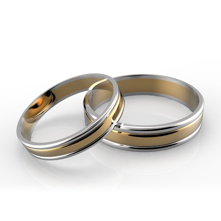 c�r�monie mariage: Gros plan de platine et des bandes de mariage d'or sur fond blanc Banque d'images