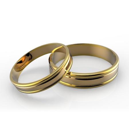 약혼: 흰색 배경에 골드 웨딩 밴드의 근접 촬영