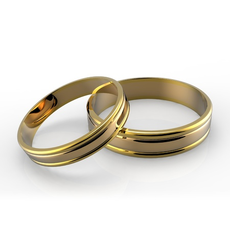 Closeup of Gold wedding bands on white background  Stock Photo - 13427773
