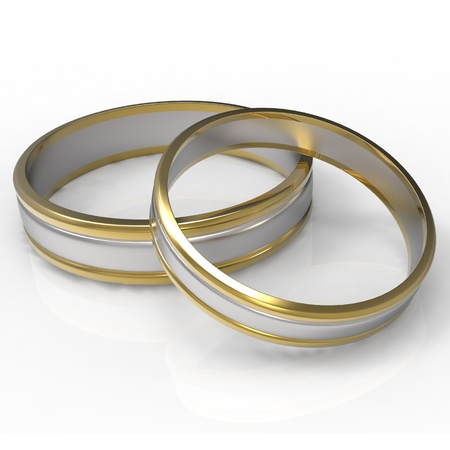 Closeup of Platinum and Gold wedding bands on white background  photo