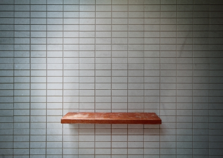 Empty wooden shelf on the tile wall. Stock Photo - 13629150