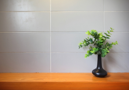 Empty wooden shelf on the tile wall. photo