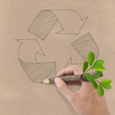 Male hand drawing recycle symbol on Brown Recycled Paper  Stock Photo - 13927020