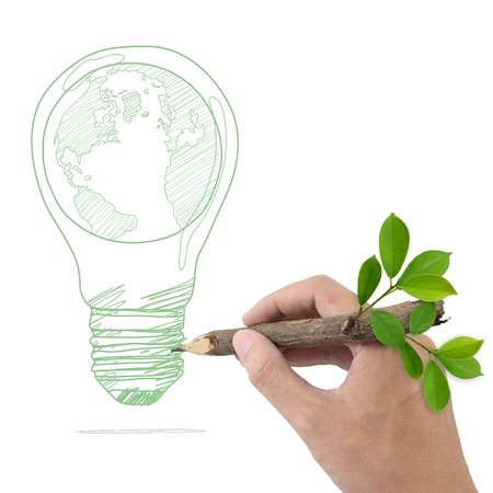 recycling plant: Male hand drawing Globe in a light bulb  Stock Photo
