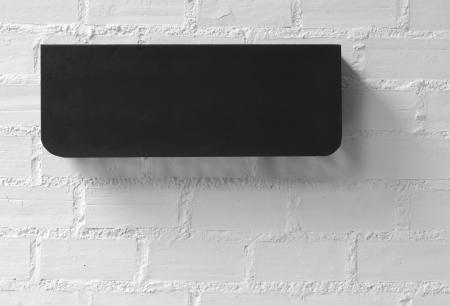 White brick wall background and Black Box.