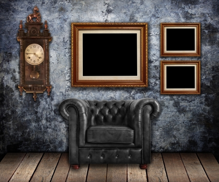 Classic leather armchair and Old clock with gold frames on Grungy wall  photo