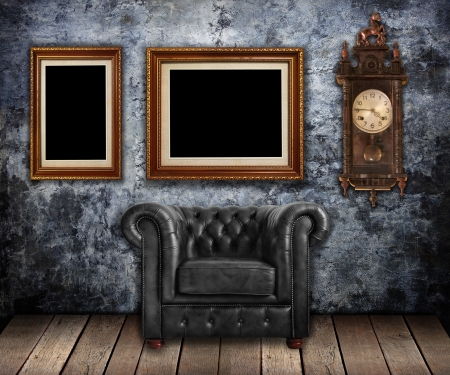 Classic leather armchair and Old clock with gold frames on Grungy wall