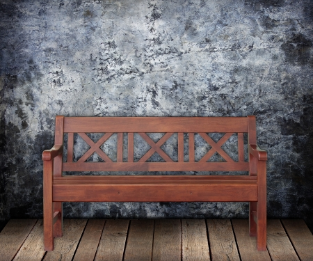 timber bench seat: Wooden bench on Grungy wall