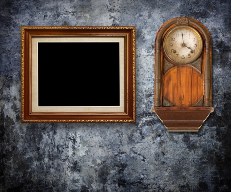 Vintage clock with Gold frames on Grungy wall  photo