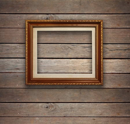 lumber room: Old wood room with gold frame background  Stock Photo