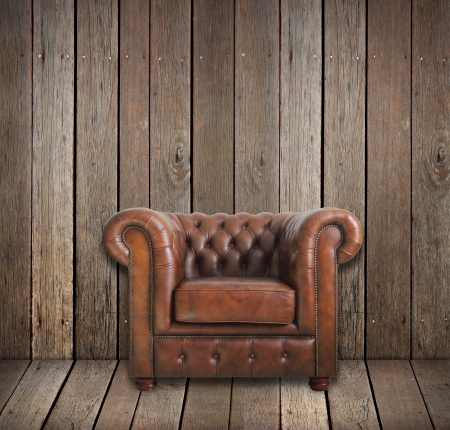 brown leather: Classic brown leather armchair in wooden room