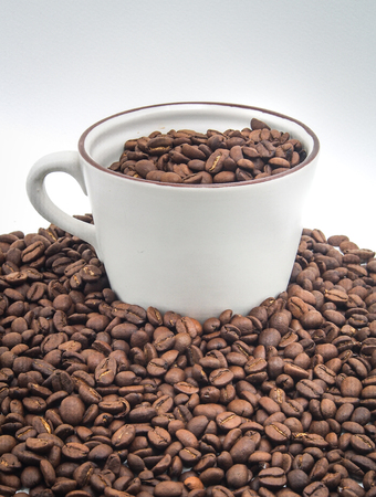Coffee bean in cup on white background.