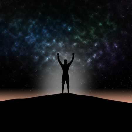 Man silhouette hands up at mountain on star light background. Reklamní fotografie