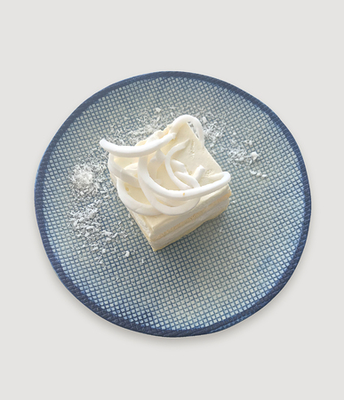 Coconut cake on dish with clipping part on white background.
