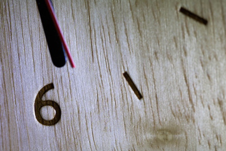 Close-up clockwise And numbers six on the Wood clock,texture. Abstract background