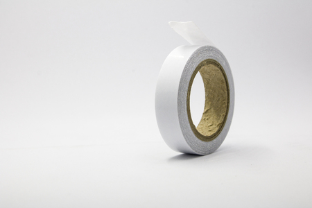 white sticky tape roll On White Background with copy space.