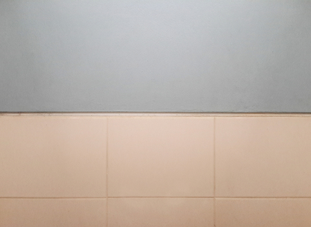 Blue wall and white tile texture. Abstract background with copy space