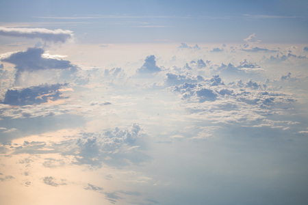 View from plane Blue sky with cloud. Clearing day in the evening Stock Photo