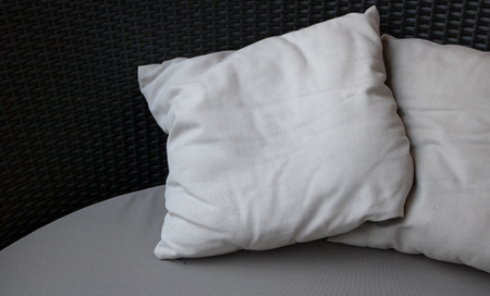 Close-up Blank white pillow on black couch background with copy space Reklamní fotografie - 122602148