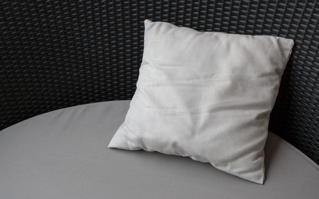 Close-up Blank white pillow on black couch background with copy space Reklamní fotografie - 122602152