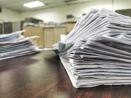 Pile of unfinished documents on the office desk, Stack of business paper with copy space