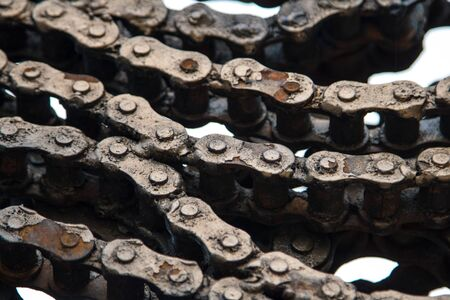 Close up of a dirty motorcycle chain with a motor oil on a wheel and metal parts. Abstract background
