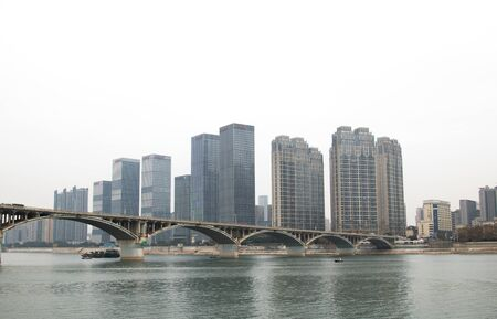 Downtown highrise skyscrapers in the capital of Changsha and bridge,Home to many corporate offices and apartment buildings with business and finance district