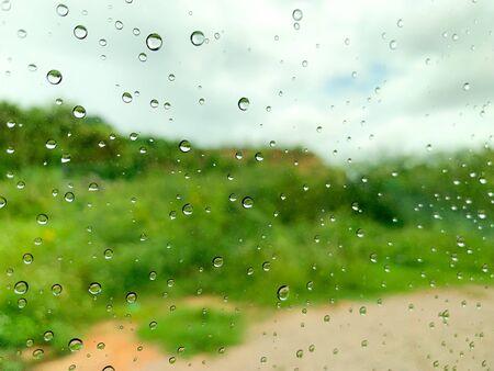 Rain drops on car window In the rainy season 版權商用圖片