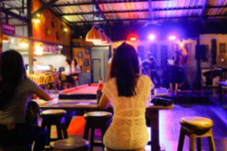 Abstract blur people enjoy at the bar pub and The atmosphere is party happy and relaxing,abstract blur background 版權商用圖片