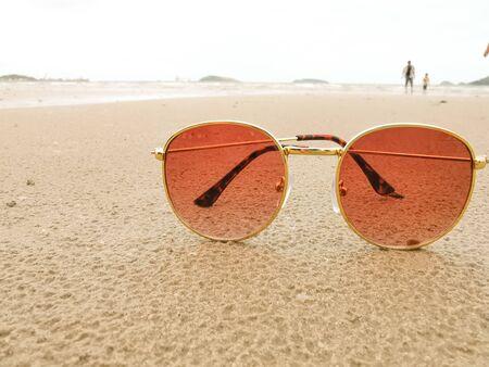 Close-up  sunglasses on the beach with copy space 版權商用圖片