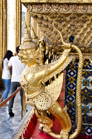 costum: Gold garuda with thai traditional costum in Wat Phra Keaw ,Bangkok,Thailand