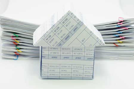 overload: House have pile overload document of report with colorful paperclip as background. Stock Photo