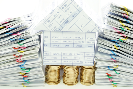 dual: House on pile of gold coins between dual pile overload document with colorful paperclip on white background.