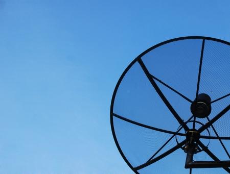 Satellite dish in blue sky  Stock Photo - 14013212