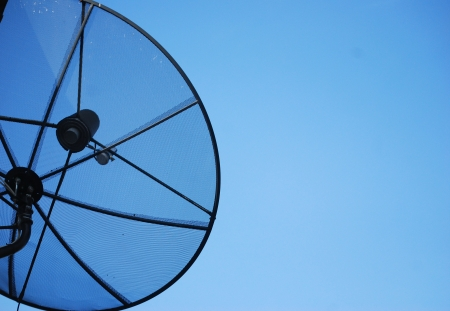 Satellite dish in blue sky Stock Photo - 14013219